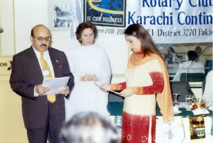 Mushtaq Talpur inducting a new lady member at Rotary Club